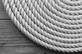 foto of coil  - Rope coil on wooden desk - JPG
