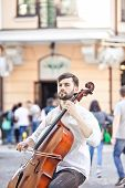 picture of cello  - The guy who plays the cello in the street in the summer - JPG