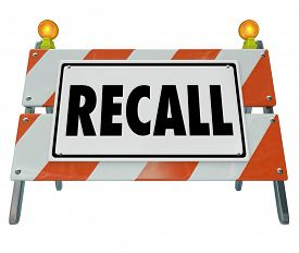 picture of dangerous  - Recall word on a barrier or blockade warning sign to illustrate a car or automobile that is defective or dangerous and needs to be fixed or repaired - JPG