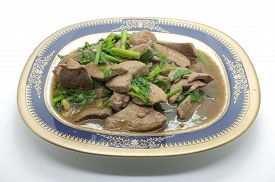 stock photo of liver fry  - Stir fried pork liver with celery on dish - JPG