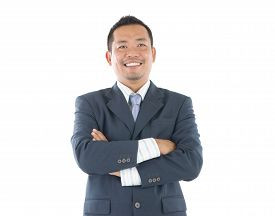 picture of southeast  - Confident Southeast Asian businessman crossed arms over white background - JPG