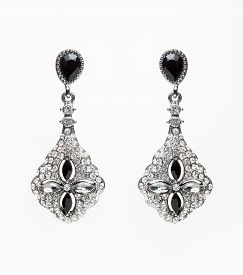 foto of lapis lazuli  - earrings with black stones on the white background - JPG