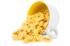 foto of inverted  - Inverted cup with corn flakes isolated on white background - JPG