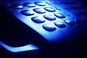 Phone Keypad in Dramatic Blue Light