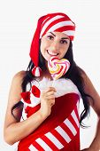 Santa Girl Holding A Lollipop. Holidays New Year And Christmas