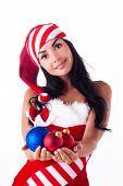 Santa Girl Holding A Christmas Ball, Christmas Toys. Holidays New Year And Christmas