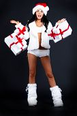 Santa Girl Scattered Boxes With Gifts. Holidays New Years And Christmas