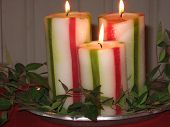 image of christchild  - photograph of three whitegreen and red striped candles - JPG