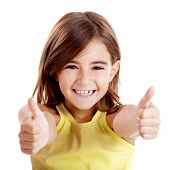 stock photo of little kids  - Portrait of a beautiful and confident girl showing thumbs up isolated one white - JPG