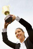 pic of woohoo  - Portrait of happy businesswoman raising championship cup - JPG