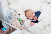Cute Newborn Baby Boy, Lying In Bed With Cold poster