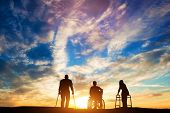 Three disabled people looking at the sunset. Idea of healing and hope. 3d illustration. poster