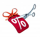 foto of scissors  - Low interest rate cut represented by scissors cutting a red price tag with a percentage sign - JPG