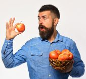 Farmer With Surprised Face Holds Red Apple. Man With Beard poster