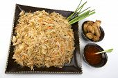 pic of pancit  - Pancit on a ceramic dish with egg rolls and sweet and sour sauce - JPG