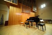 image of pipe organ  - Massive wooden pipe organ and black concert grand piano in light hall - JPG