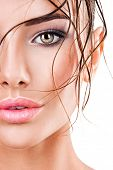 Closeup half face of beautiful woman with dark brown eye makeup. Macro portrait of female eyes with  poster