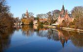 lake reflects of littel palace. Bruges
