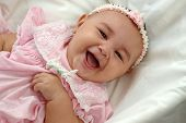 Cute Baby Girl In Pink Laughing poster