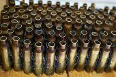 Brass Cases Of Cartridges In Machine-gun Tape poster