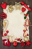 Christmas abstract background border with bauble decorations, holly and mistletoe on parchment paper poster