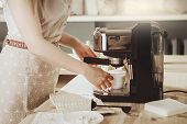 Woman Making Fresh Espresso In Coffee Maker. Coffee Machine Makes Coffee. poster