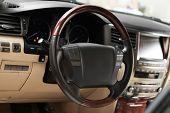 Steering wheel in modern car saloon poster