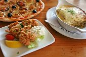 image of italian food  - Traditional italian food pizza lasagna fried oysters - JPG