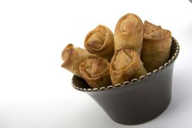 image of lumpia  - Crispy Egg rolls in a ceramic bowl isolated - JPG