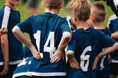 Children In Soccer Team. Young Boys Standing In A Team With Coach. Close-up Of Football Team Standin poster
