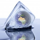 Frozen earth globe inside the ice cube.