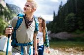 Hiking With Friends Is So Fun. Group Of Young People With Backpacks Hiking Together poster