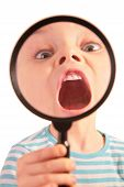 Child With Open Mouth Through Magnifier