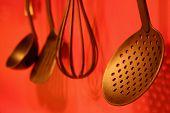 foto of kitchen utensils  - utensils on red wall - JPG