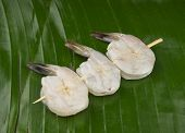 delicious fresh shrimp on a green banana leaf peeled with Skewer
