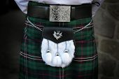 Traditional Scottish outfit. Kilt and sporran.
