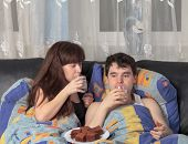 picture of have sweet dreams  - A young couple has breakfast in bed - JPG