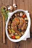 Chicken legs roasted with the mushrooms and potato