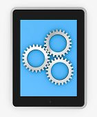 stock photo of tablet pc computer  - one tablet pc with three gears concept of data processing  - JPG