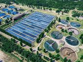 Modern Wastewater Treatment Plant With Round Ponds For Recycle Dirty Sewage Water, Aerial View From  poster
