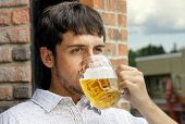 Young Guy Drinking Beer