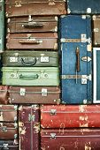 Suitcases For Travel. Multicoloured Suitcases For Clothes. Background. Texture. poster