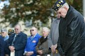 NEW YORK - NOV 11: Retired Judge and war veteran Maurice Harbater (R) and others pray at a Veteran's Day Memorial service at St. John's University November 11, 2005 in Queens, NY.
