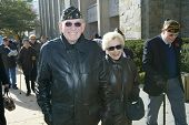 NEW YORK - NOV 11: Retired Judge and veteran Maurice Harbater (L) and his wife, Marilyn Harbater, attend the Veteran's Day Memorial service at St. John's University November 11, 2005 in Queens, NY.
