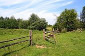 wooden fence on green pasture