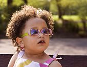 Young Black Baby Girl With Glasses