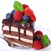 pic of brownie  - Piece of chocolate cake with icing and fresh berry on white isolated background - JPG