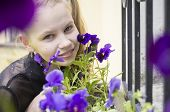 young girl sniffing beautifull flowers