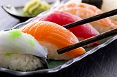 stock photo of plate fish food  - sushi with chopsticks - JPG