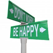 Two-way street or road signs pointing in different directions with the words Don't Worry and Be Happ
